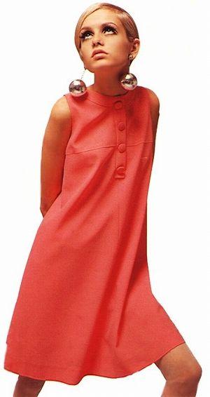 Twiggy in salmon dress.