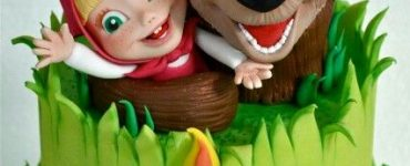 One-floor cake with Masha and the Bear hugging each other on top.