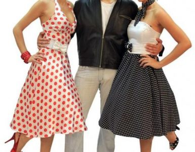 Two women and a man in 60s clothes.