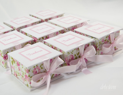 flowered fabric boxes with a pink bow around them