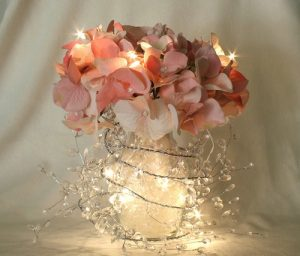 centerpiece for a wedding with flowers and lights