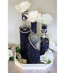 wedding table center with bottle of wine