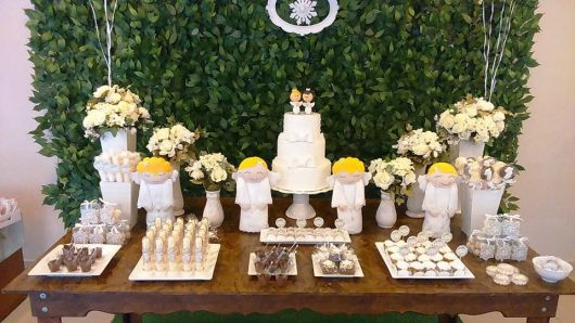 christening table with rustic wood