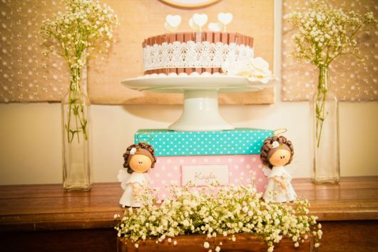 christening table with angel prints
